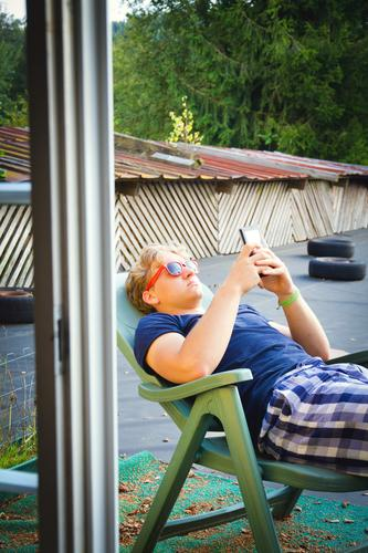relaxation Lifestyle Contentment Relaxation Summer Deckchair Cellphone PDA Entertainment electronics Information Technology Youth (Young adults) 1 Human being