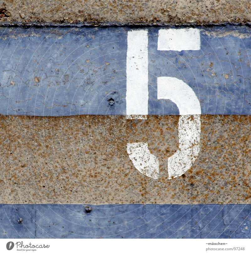 White Blue Wall (barrier) Brown Places Digits and numbers 5 Division Rust Traffic infrastructure Fate Numbers