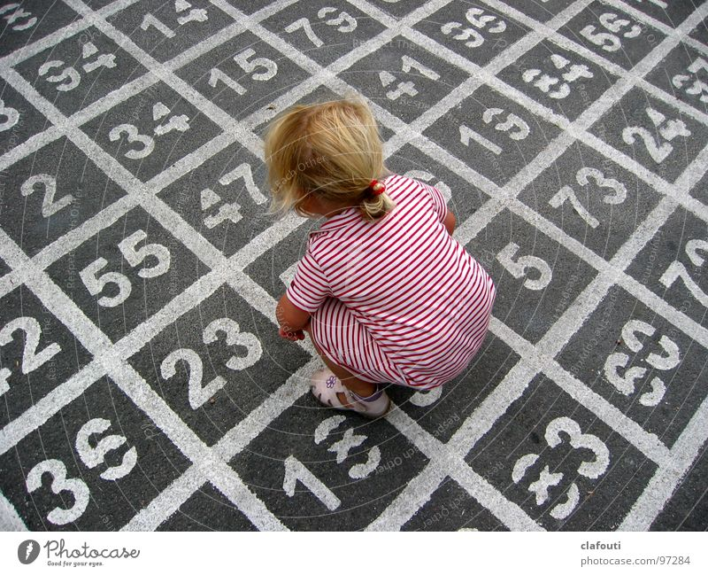 Child Girl Playing Study or Survey Infancy Bird's-eye view Human being Digits and numbers Dress Asphalt Day Calculation Crouch Numbers Mathematics PISA study