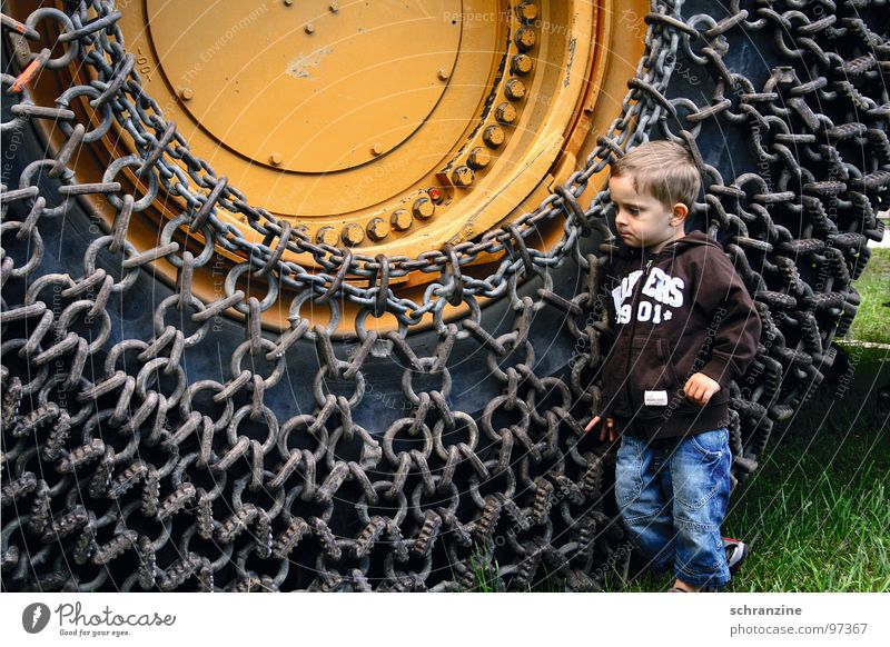 Human being Child Boy (child) Think Small Large Industry Might Construction site Truck Discover Machinery Toddler Tire Chain