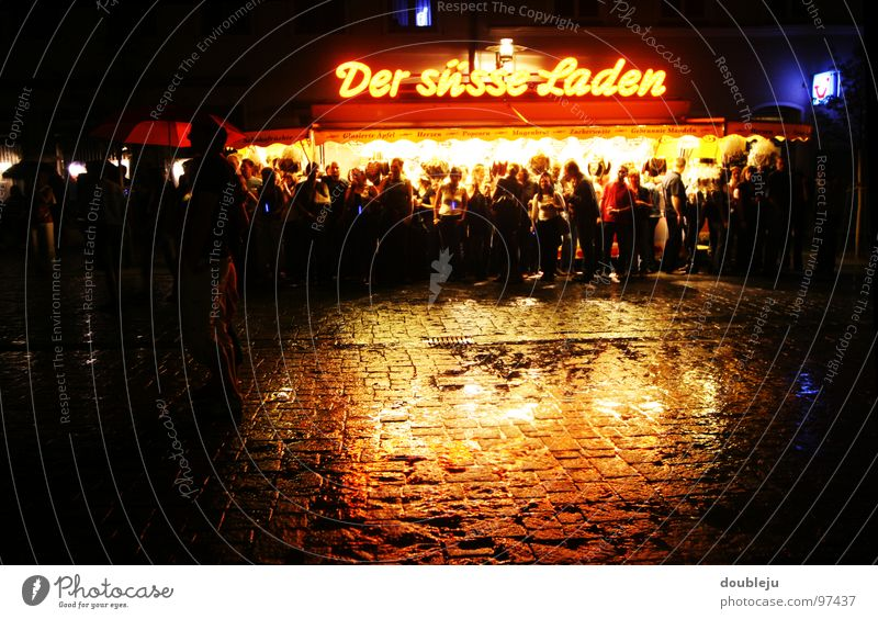 the sweet load Night Storm Damp Reflection Sell Light Fairs & Carnivals Neon sign Dark Hiding place Crowd of people Concert Audience Asphalt Gastronomy Rain