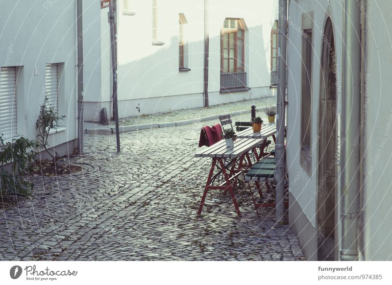 outside is still so cold Vacation & Travel City trip Erfurt Small Town Old town Deserted Old building Cobblestones Idyll Café Exterior shot Table Chair