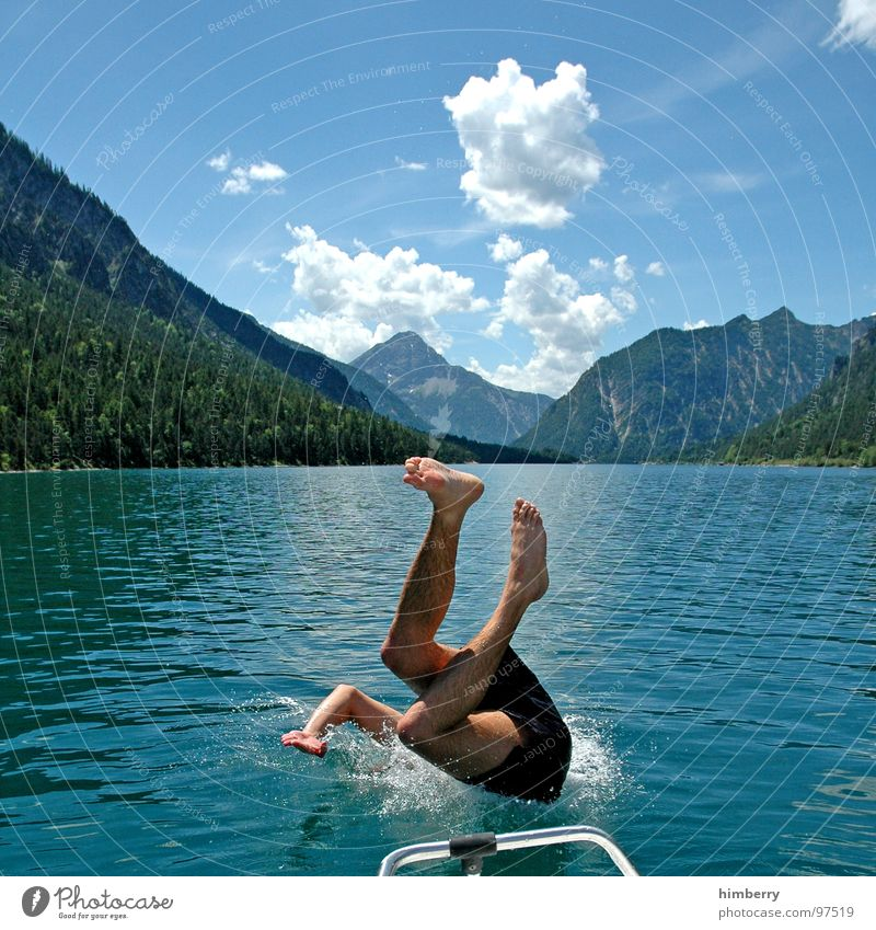 Human being Man Hand Youth (Young adults) Water Vacation & Travel Jump Mountain Lake Legs Watercraft Horizon Swimming pool Leisure and hobbies