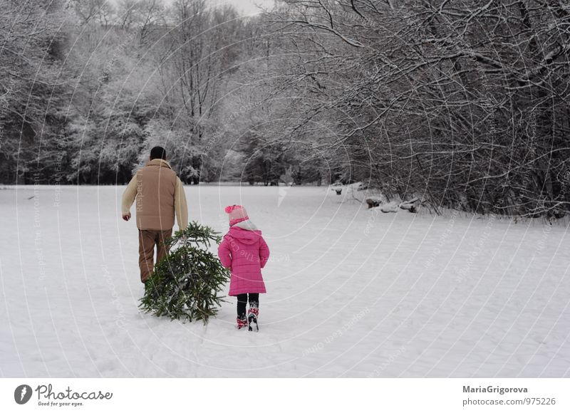 Taking Home a Christmas Tree Lifestyle Joy Winter Snow Winter vacation Mountain Christmas & Advent Human being Child Girl Man Adults Parents Father Body 2
