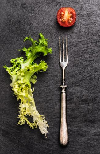 Fork, salad and tomatoes on slate Food Vegetable Lettuce Salad Nutrition Lunch Buffet Brunch Banquet Organic produce Vegetarian diet Diet Lifestyle Style Design