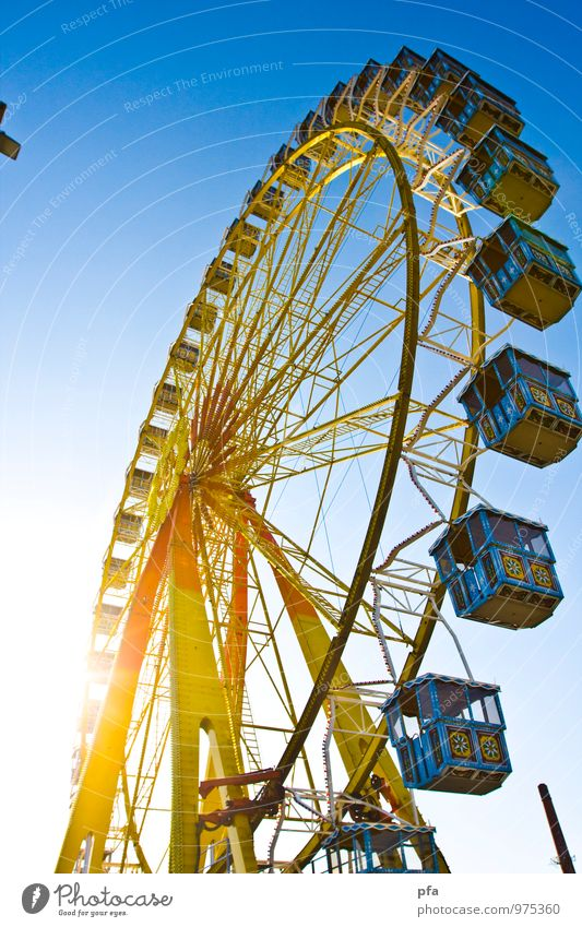 Ferris wheel in the sun Fairs & Carnivals Sun To swing Free Tall Above Blue Yellow Colour photo Multicoloured Exterior shot Copy Space left Day Light Sunlight