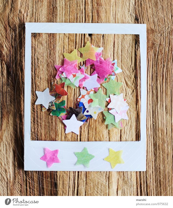 Polaroid with star motif Sign Digits and numbers Emotions Retro Frame Stars Star (Symbol) Christmas & Advent Wooden table Structures and shapes Beautiful