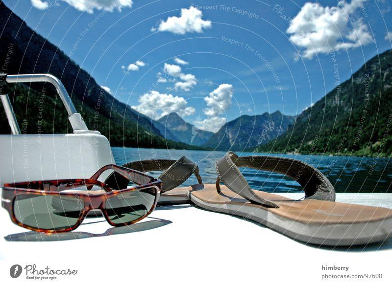 Sky Water Summer Clouds Playing Mountain Lake Watercraft Swimming & Bathing Leisure and hobbies Eyeglasses Sunglasses Flip-flops