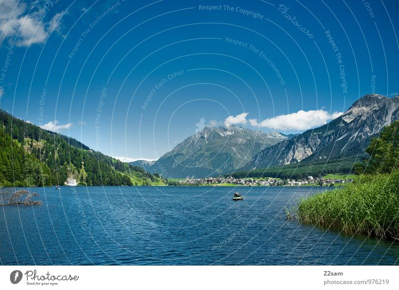 Reschensee Nature Landscape Sky Summer Beautiful weather Tree Bushes Hill Rock Alps Mountain Peak Lakeside Fresh Sustainability Natural Blue Green Calm