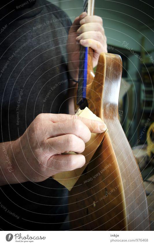 grind Work and employment Profession Craftsperson Joiner bassbauer Instrument making Workshop Craft (trade) Adults Hand 1 Human being Sandpaper Guitar