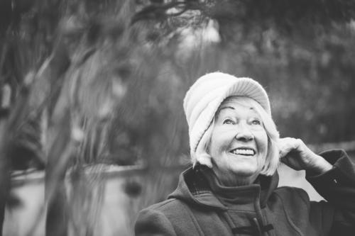 Grandma's happy. Feminine Grandmother Senior citizen Life 1 Human being 60 years and older Coat Hat Cap White-haired Smiling Laughter Wait Old Friendliness
