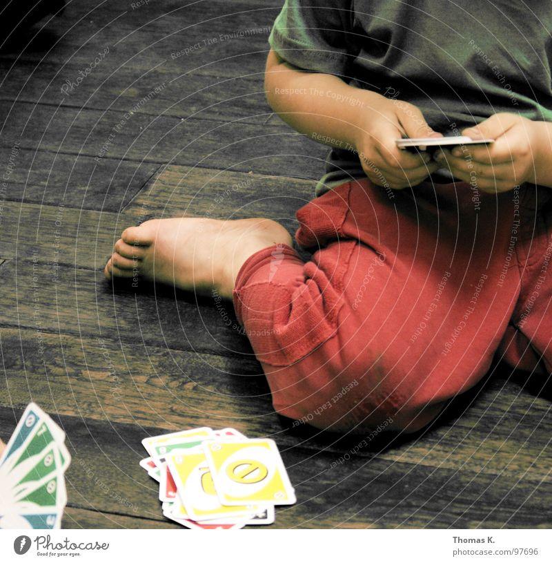 Hand Playing Wood Floor covering Pants Wooden floor Knee Fiber Game of cards