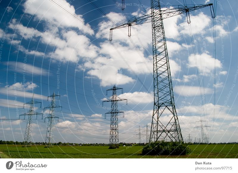 Sky Blue Clouds Tall Industry Action Electricity Open Thin Middle Under Radiation Manmade structures Electricity pylon Geometry Noble