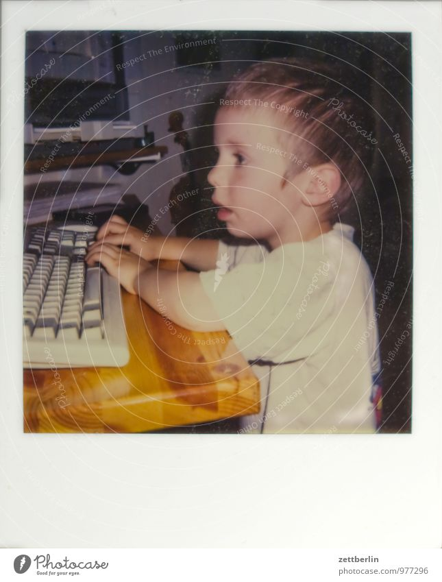digital native Old Collection Photography Art gallery Polaroid Computer Child Toddler office Playing Computer games Digital Keyboard Head Table Watchfulness