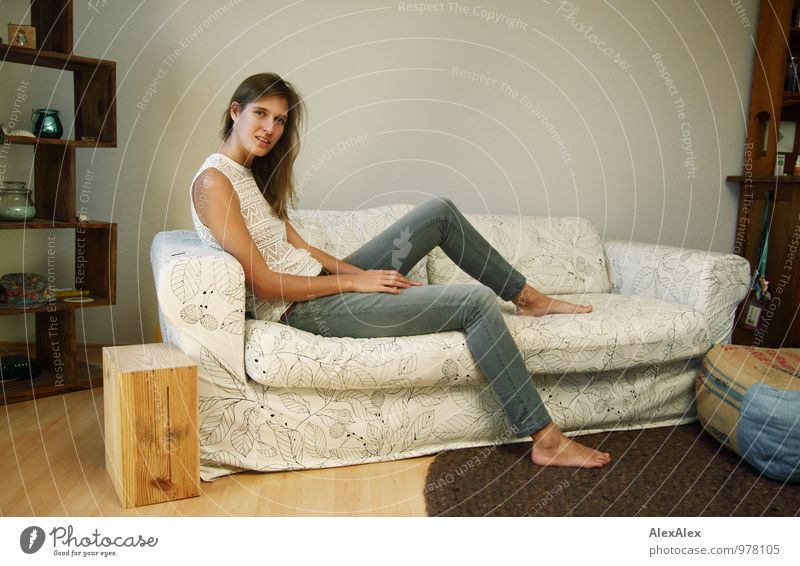 couchsurfer Flat (apartment) Sofa Living room Young woman Youth (Young adults) Legs Barefoot 18 - 30 years Adults Jeans Top Brunette Long-haired Sit Esthetic