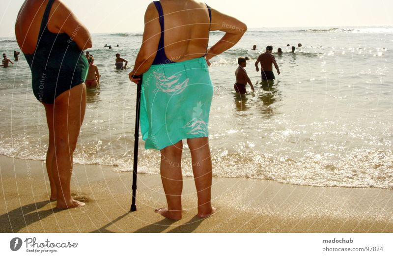 Human being Woman Sky Water Vacation & Travel Summer Sun Ocean Joy Beach Relaxation To talk Senior citizen Sand Legs Friendship