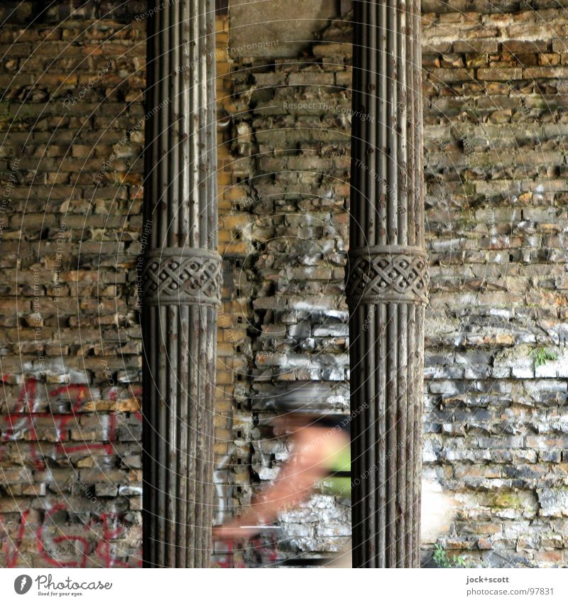 Hartungschen columns Cycling 1 Human being Prenzlauer Berg Tunnel Manmade structures Wall (building) Metal Rust Brick Historic Speed Moody Force Movement