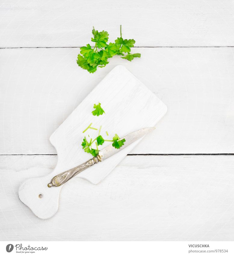 Parsley leaves on white chopping board Food Herbs and spices Nutrition Knives Lifestyle Style Design Healthy Eating Leisure and hobbies Chopping board Table