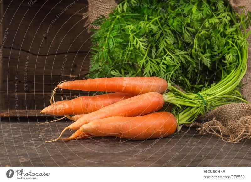 Carrot bunch Food Vegetable Nutrition Organic produce Vegetarian diet Diet Style Design Bundle Leaf Green Fresh Harvest Garden Wood Crate Sack Table Dark