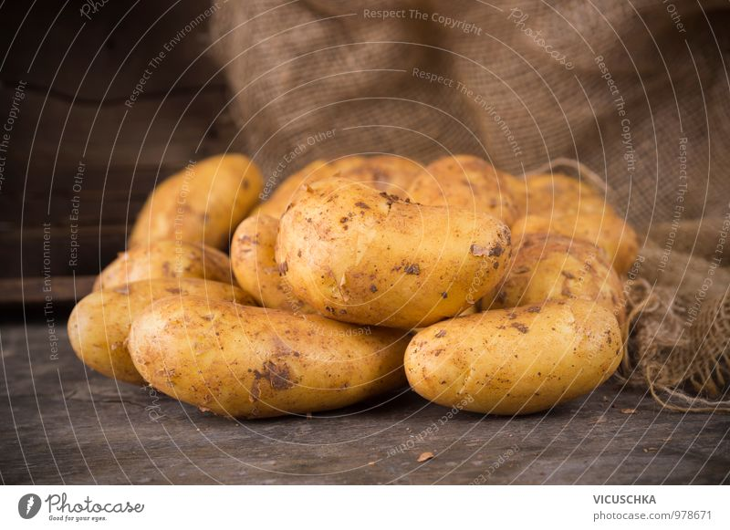 Fresh potatoes on a rustic wooden table Food Vegetable Nutrition Organic produce Vegetarian diet Diet Style Design Garden Sack Nature Potatoes Wooden table
