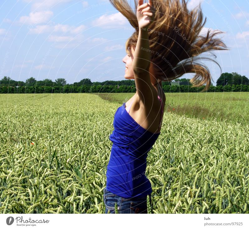 Woman Nature Youth (Young adults) Girl Sky Green Blue Clouds Far-off places Jump Hair and hairstyles Air Field Flying Search Large