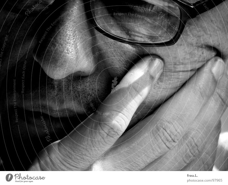 Man Hand Face Dream Mouth Eyeglasses Reading Wrinkles Concentrate 50 plus Facial hair Fatigue Redecorate Magazine Sunday Absentminded