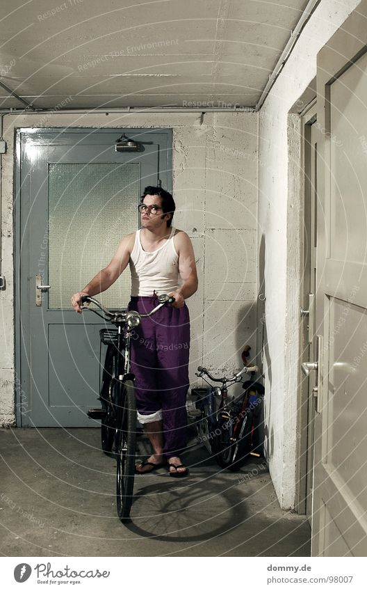 Man Door Bicycle Stand Eyeglasses Pants Cellar Fellow Person wearing glasses Undershirt Cellar door