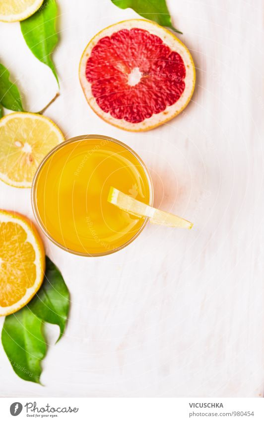 Glass of orange juice with slices of citrus fruit Food Fruit Orange Nutrition Beverage Cold drink Juice Style Design Healthy Eating Life Garden Kitchen Nature