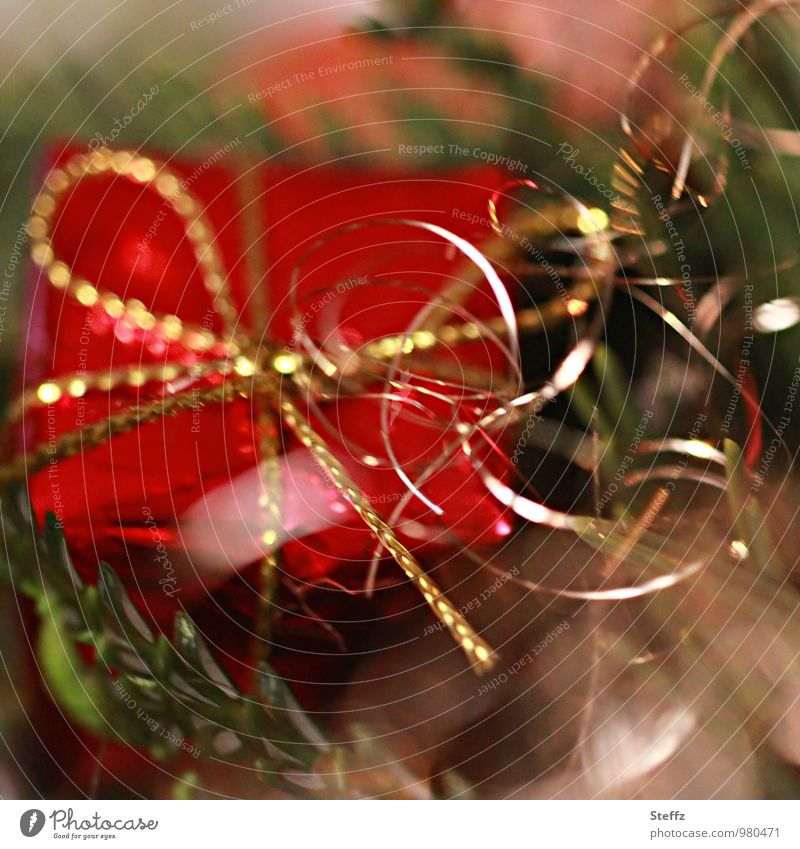 Christmas surprise Anticipation Giving of gifts Christmas gift Gift Christmas tree Tradition Elegant Glittering Donate Happiness Curiosity Gold shiny gold Red