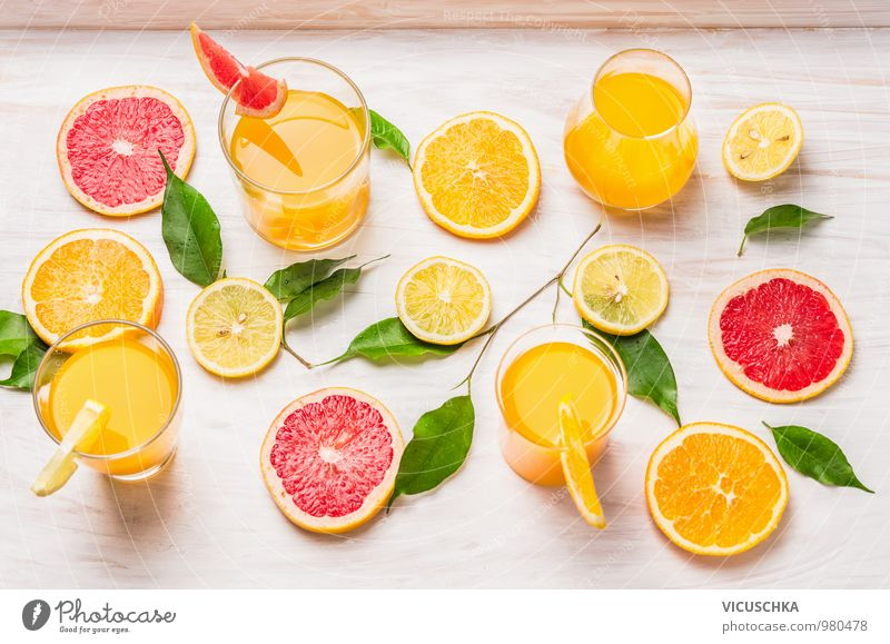 Citrus juices and pieces of orange, grapefruit and lemon Food Fruit Orange Nutrition Organic produce Vegetarian diet Diet Beverage Juice Glass Style Design