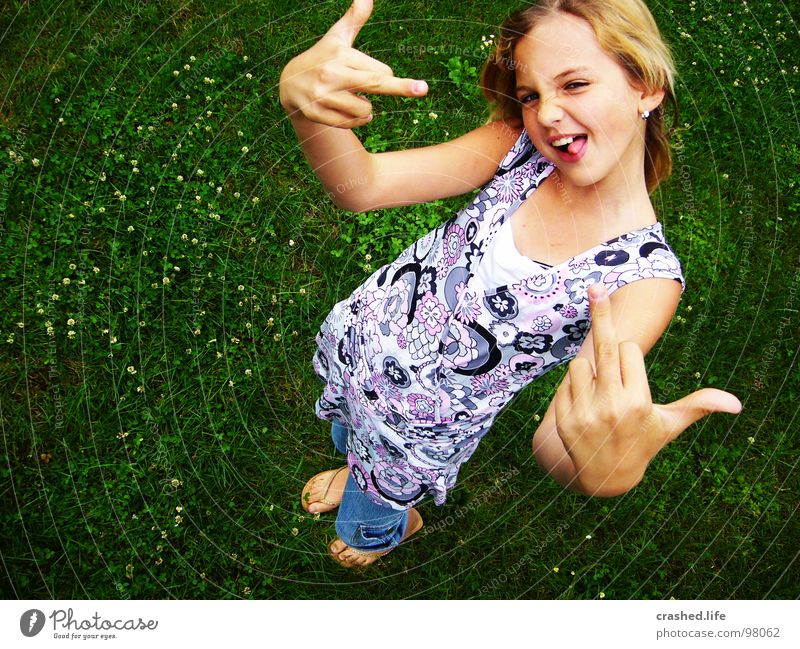 Child Youth (Young adults) Green Face Laughter Posture Dress Hind quarters Pants Evil Brash Tongue Flip-flops Middle finger
