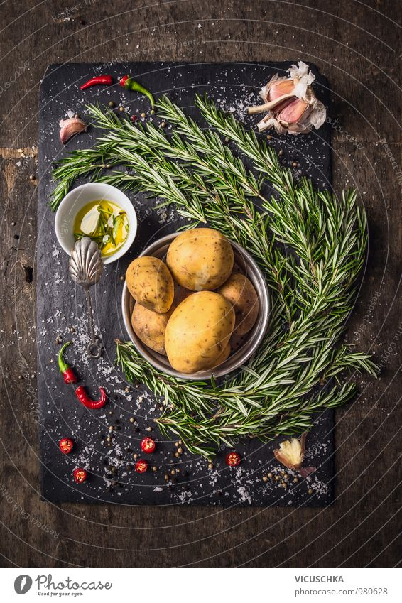 Ingredients for rosemary potatoes with spices and oil Food Vegetable Herbs and spices Cooking oil Nutrition Banquet Organic produce Vegetarian diet Diet Style
