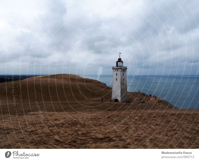 Lighthouse on shifting sand dune at the sea Ocean coast Vacation & Travel Adventure Far-off places Freedom Nature Landscape Sand Water Clouds Ruin