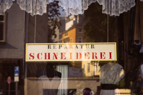 The Retro-Cutterlet Window Tailor Repair Tailoring Tailor's shop Signs and labeling Curtain Shop window Sewing Reflection Services Craftsperson Craft (trade)