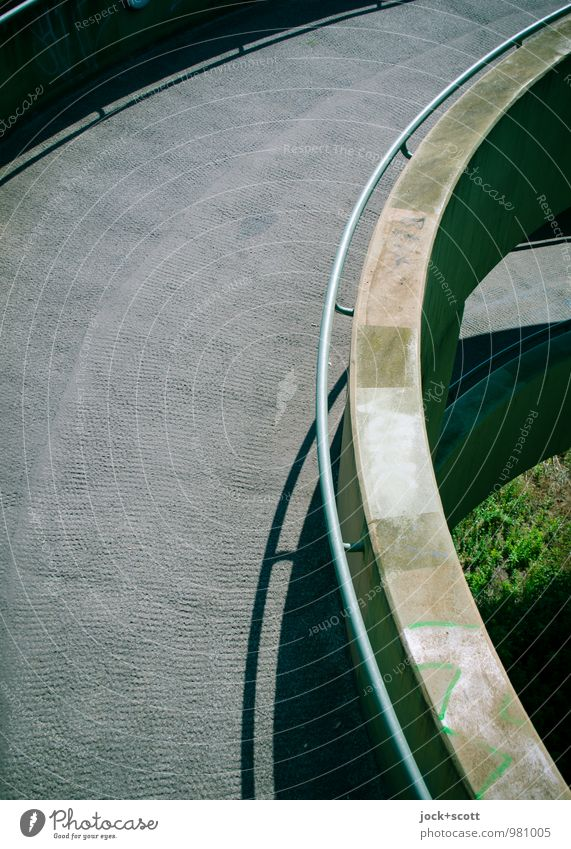 Ramp in semicircle Grass Bridge Bridge railing Concrete Semicircle Spiral Tall Modern Above Gloomy Gray Safety Symmetry Lanes & trails Shadow play Story