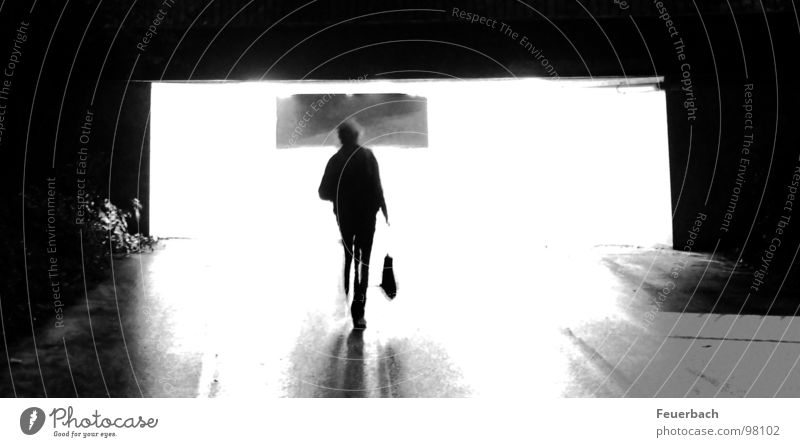 At the end of the tunnel... it'll get dark again. Black & white photo Exterior shot Light Shadow Contrast Back-light Long exposure Human being Rain Tunnel