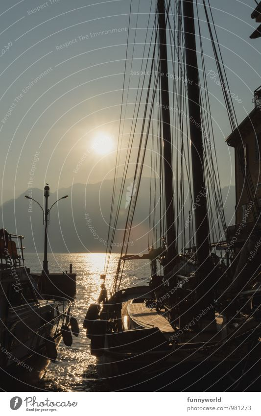 ship sunset romanticism Lifestyle Vacation & Travel Navigation Sailboat Sailing ship Harbour Kitsch Safety Idyll Romance Colour photo Subdued colour