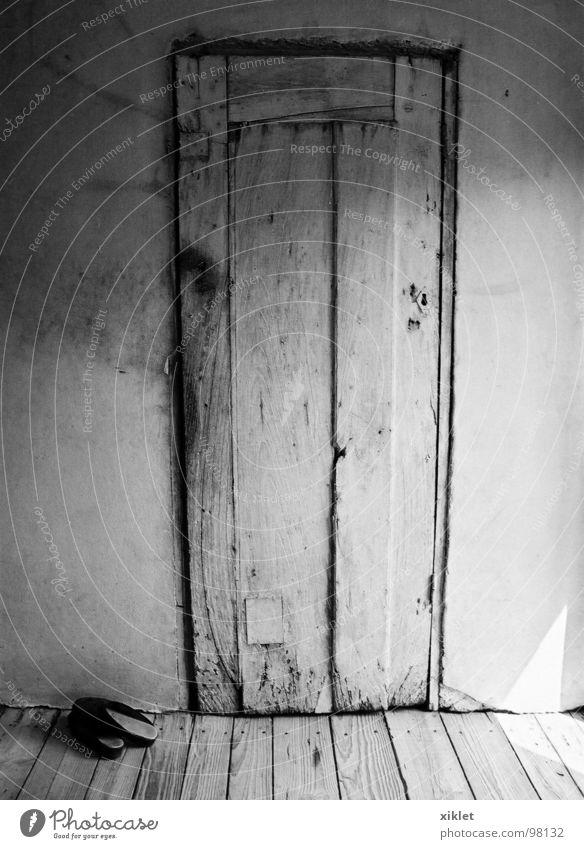 door Black White Wood Gray Footwear Wooden floor Wall (building) Historic Door Poverty Sun Rural Room Concrete Black & white photo Deserted Wooden door Old