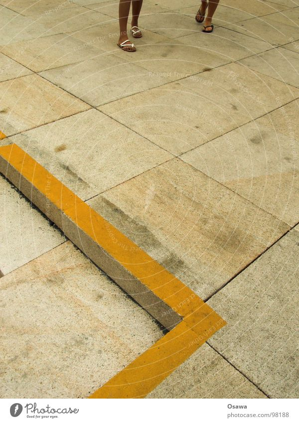 Summer Yellow Gray Stone Legs Line Feet Stairs Signs and labeling Concrete Floor covering Corner Tile Warning label Traffic infrastructure Beige