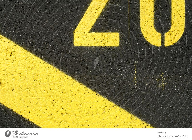 number 20 Yellow Black Parking lot Digits and numbers street lettering