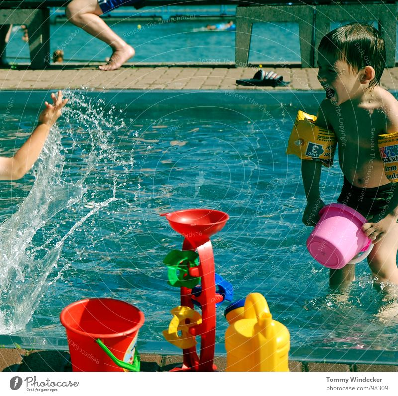 bathing fun Brave Wet Cold Refreshment Physics Swimming pool Swimming trunks Open-air swimming pool Bucket Red Yellow Playing Vacation & Travel