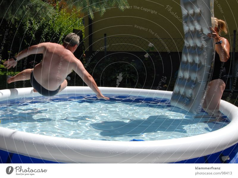 Oh you disc... Swimming pool Playing Wet Cooling Refrigeration Fat Jump Relaxation Action Air mattress Damp Water Blue Shadow Overweight Water basin Man Woman
