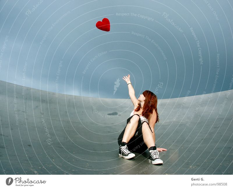 take heart... Woman Young woman Catch Touch Bad weather Clouds Location Satellite dish Footwear Chucks Gray Red Flying Symbols and metaphors Cushion Heart