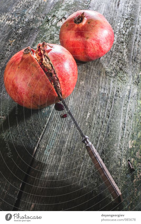 Pomegranate on wooden table Fruit Eating Vegetarian diet Juice Table Nature Fresh Juicy Red Colour knife ripe background Organic healthy sweet Raw food seed