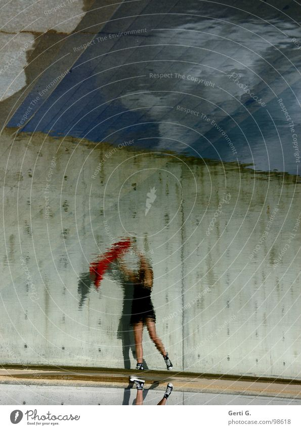 reflection Reflection Surface of water Distorted Woman Mini skirt Black Little black dress Jacket Wind Throw in the air Wall (barrier) Wall (building) Sky blue
