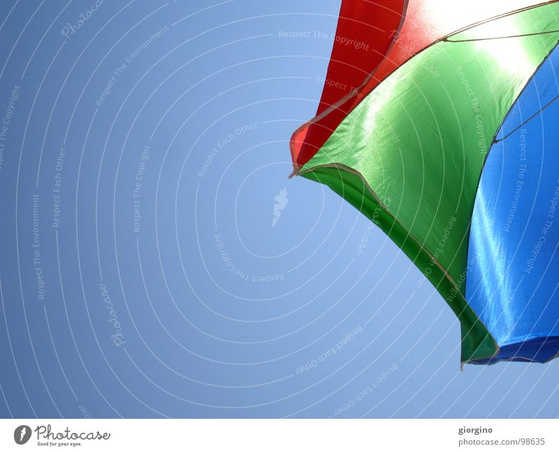 Umbrella at the seaside 1 Sky Background picture Colour Joy umbrella blue red black sea and composition free