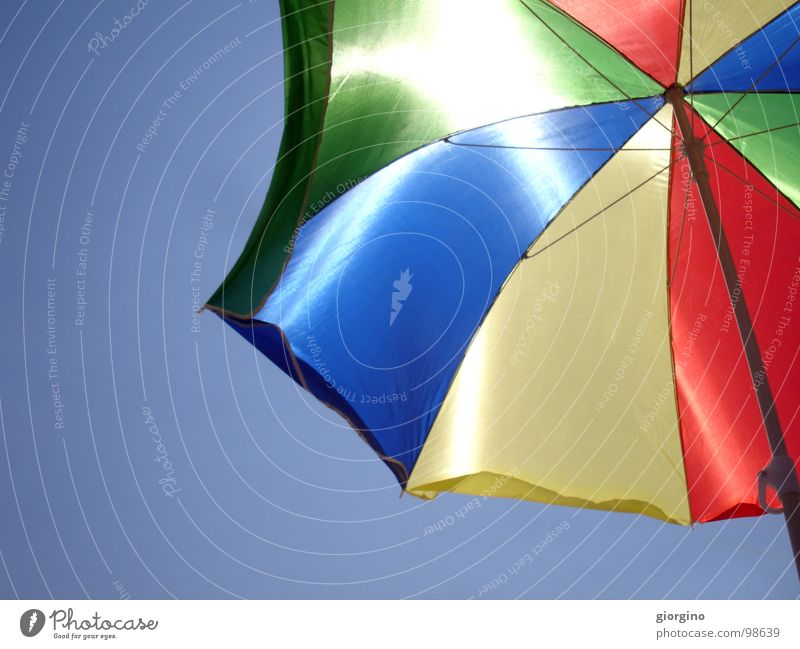 Umbrella at the seaside 2 Sky Background picture Colour Joy umbrella blue red black sea and composition free