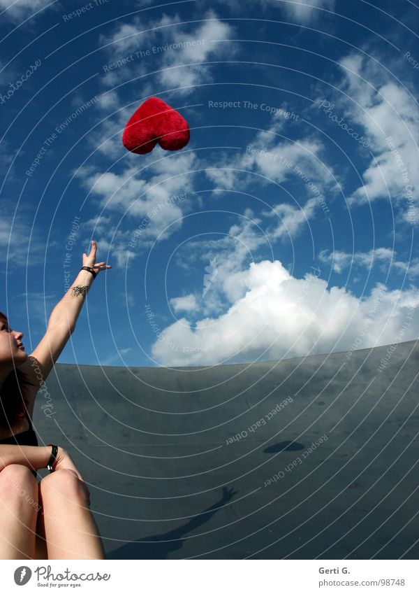 long-distance relationship Woman Young woman Catch Touch Sky blue White Clouds Bad weather Gray Red Flying Symbols and metaphors Cushion Heart Decoration