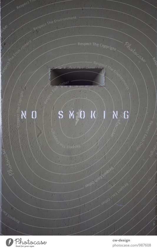 NE Wall (barrier) Wall (building) Facade Concrete Sign Characters Signs and labeling Signage Warning sign Smoking Dark Sharp-edged Cold Trashy Gray Virtuous