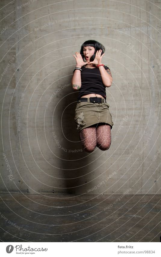 jump Woman Youth (Young adults) Jump Far-off places Beautiful Interesting Concrete Wall (building) Surprise Scream Air Stockings Aggravation Portrait photograph
